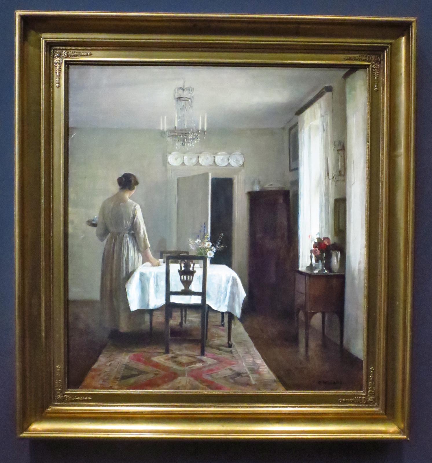 La femme de l'artiste devant la table de  Carle Holsoe,