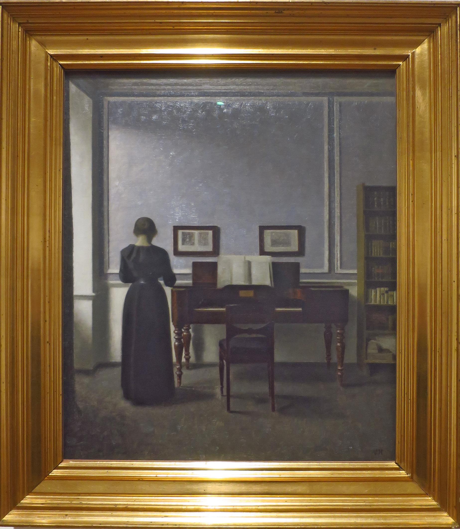 Intérieur avec piano et femme en noir 1901
